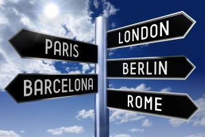 Signpost with 5 arrows - capital cities (London, Paris, Berlin, Barcelona, Rome) - great for topics like traveling, sightseeing etc.